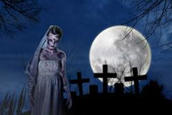 お墓に立つ死者の画像